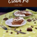 Chocolate Cream Pie slice on a white plate with fork & chocolate on a green polka dot towel Pinterest banner.