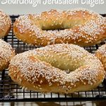 Sourdough Jerusalem Bagels cooling on rack closeup Pinterest banner