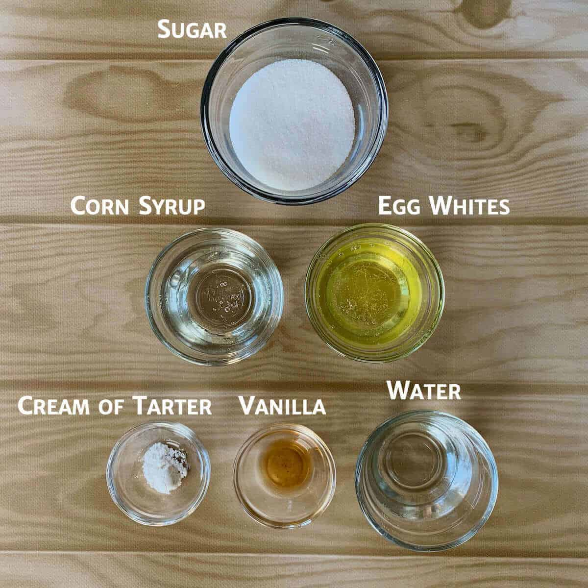 Marshmallow Creme ingredients in glass bowls on a table.