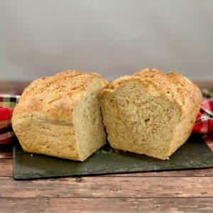 Sliced Multigrain Sourdough Sandwich Bread loaf on slate