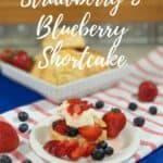 Strawberry Blueberry Shortcake plated on red striped towel Pinterest banner.