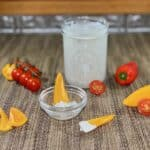 buttermilk blue cheese dressing in jar with vegetables