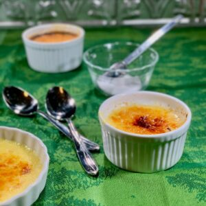 Finished Creme Brulee closeup with spoons and sugar