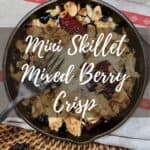 Mixed Berry Crisp on towel with fork overhead Pinterest banner