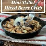 Mixed Berry Crisp on towel with lifted fork Pinterest banner