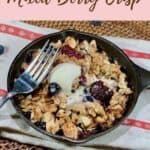 Mixed Berry Crisp on towel with fork Pinterest banner