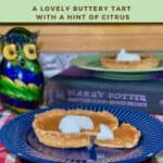 Treacle Tart sliced & plated on blue plate with tart on green plate on book & glass owl in background Pinterest banner