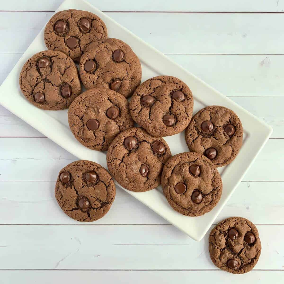 Chocolate Chocolate Chip cookies on white tray from overhead.