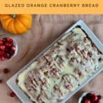 Glazed Orange Cranberry Bread whole with pumpkins & cranberries from overhead Pinterest banner