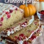 Glazed Orange Cranberry Bread sliced closeup with pumpkins & cranberries Pinterest banner