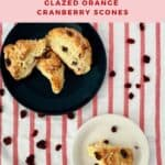 Orange Cranberry Scones plated on white plate & stacked on blue plate from overhead Pinterest banner