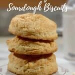 sourdough biscuits stacked on mat closeup Pinterest banner