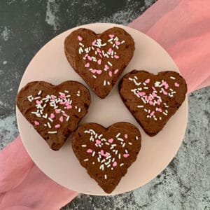 Four heart shaped Fudge Brownies on cakestand from overhead