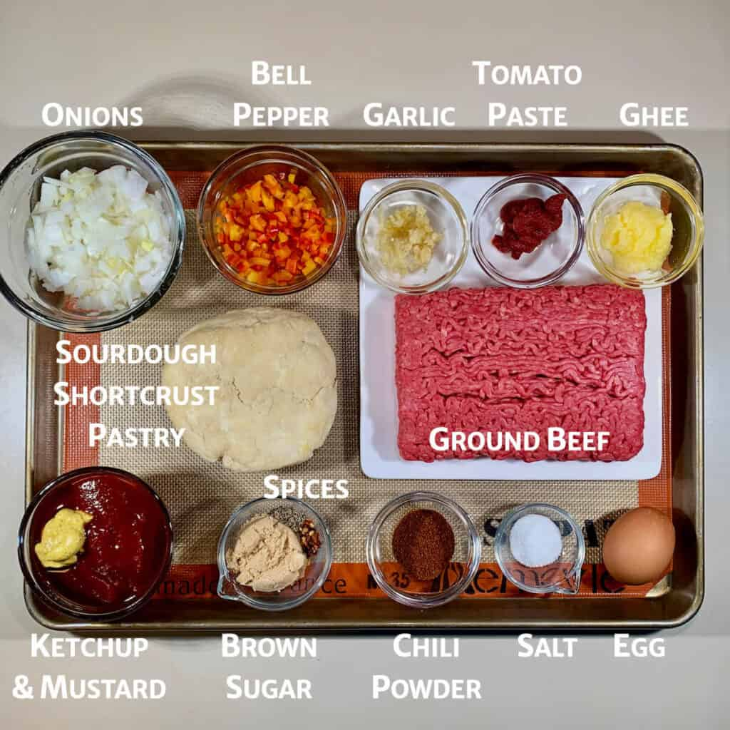 Ingredients for Sloppy Joes pasties on tray from overhead marked