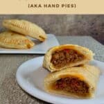Sloppy Joes Pasties plated & sliced with 2 stacked in background Pinterest banner