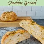 Sourdough Jalapeño Cheddar Bread sliced open closeup with loaf behind on cutting board Pinterest banner