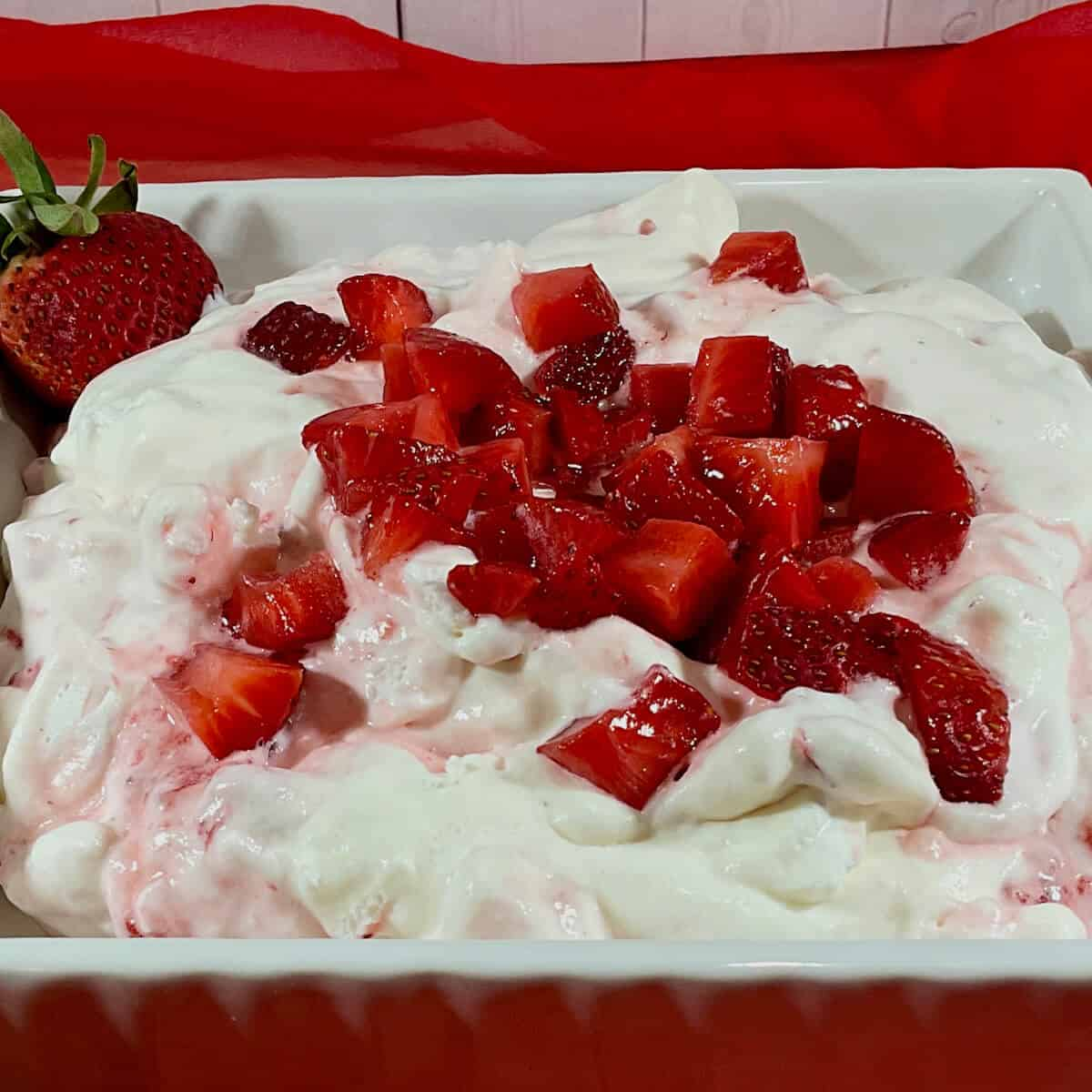 Eton Mess in a bowl on red scarf closeup