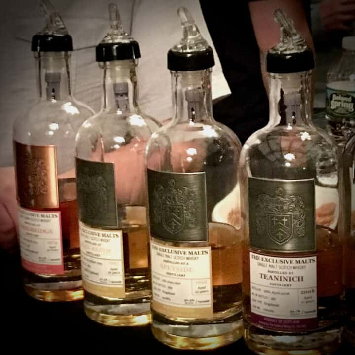 Some of the Exclusive Malts bottles on a table.