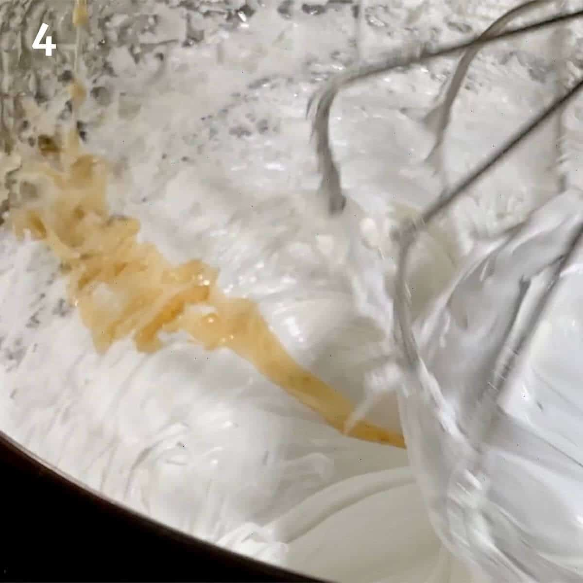 Adding vanilla to marshmallow creme.