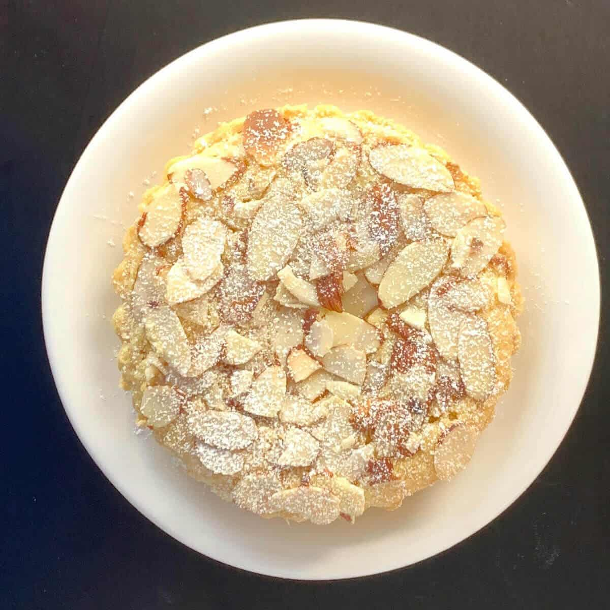 Mini Bakewell Tart on a white plate from overhead.