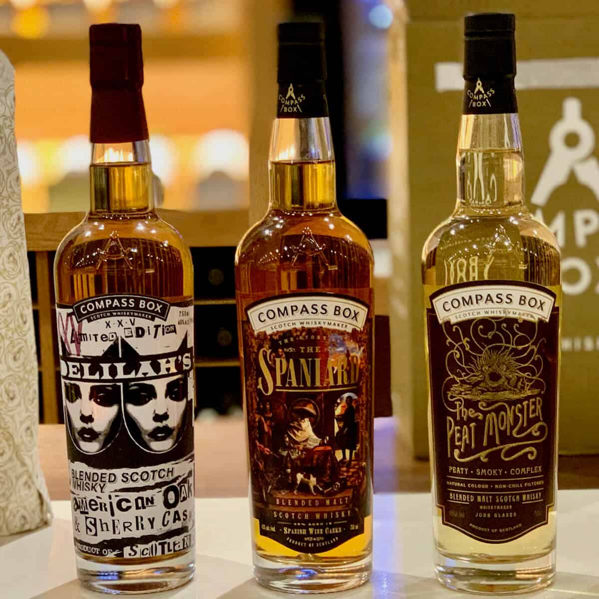 Compass Box Blended Scotch partial lineup in bottles on a counter.