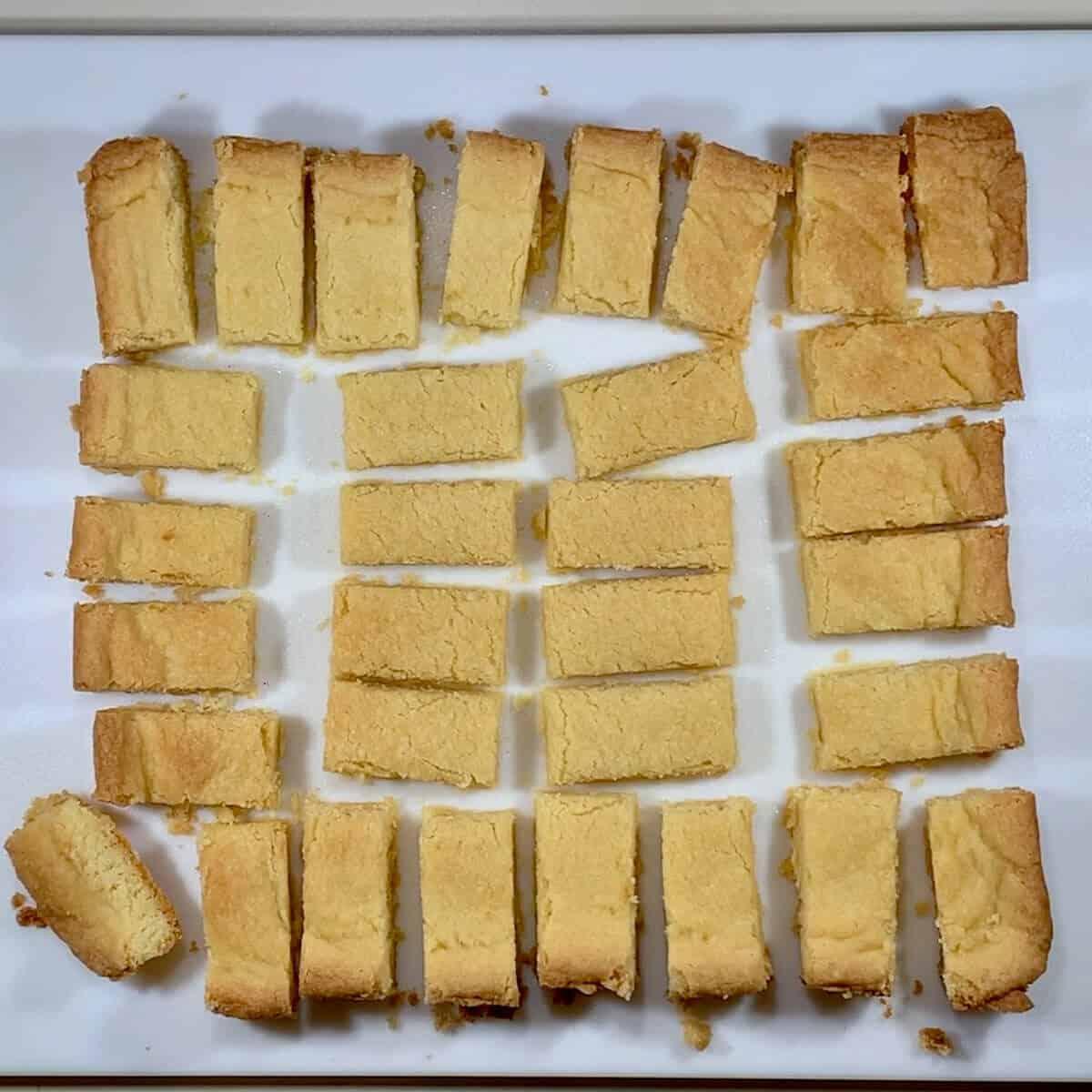 Shortbread bars on a cutting board.