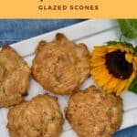 Maple Walnut Scones on a white tray with a sunflower on a blue background from overhead Pinterest banner.