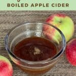 Boiled apple cider in a glass bowl with apples Pinterest banner.